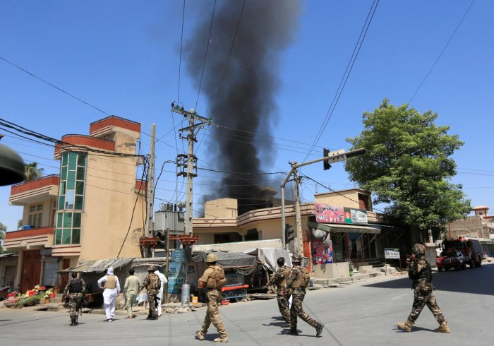 Smoke rises from an area where explosions and gunshots were heard, in Jalalabad city, Afghanistan July 31, 2018. REUTERS/Parwiz