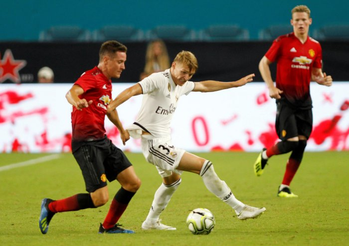 Manchester United's Ander Herrera in action with Real Madrid's Martin Odegaard. Reuters