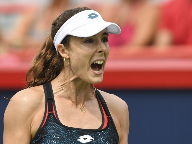Alize Cornet of France was issues a code violation for changing her dress on the court. AFP FILE PHOTO
