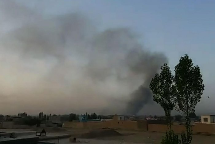 This screen grab taken from AFPTV video on August 10, 2018 shows smoke rising into the air after Taliban militants launched an attack on the Afghan provincial capital Ghazni, with terrified residents cowering in their homes amid explosions and gunfire. -