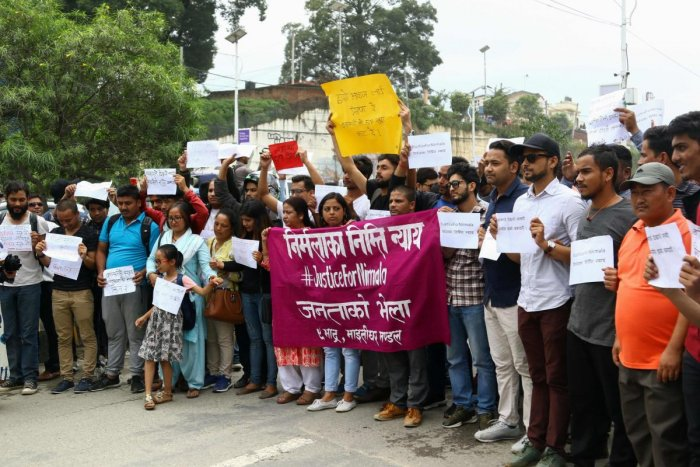 Nepali activists take part in protest rally, demanding justice after the rape and murder of a 13-year-old girl, in Kathmandu on August 25, 2018. - One person was killed and dozens injured in Nepal when police opened fire on protesters demanding action ove