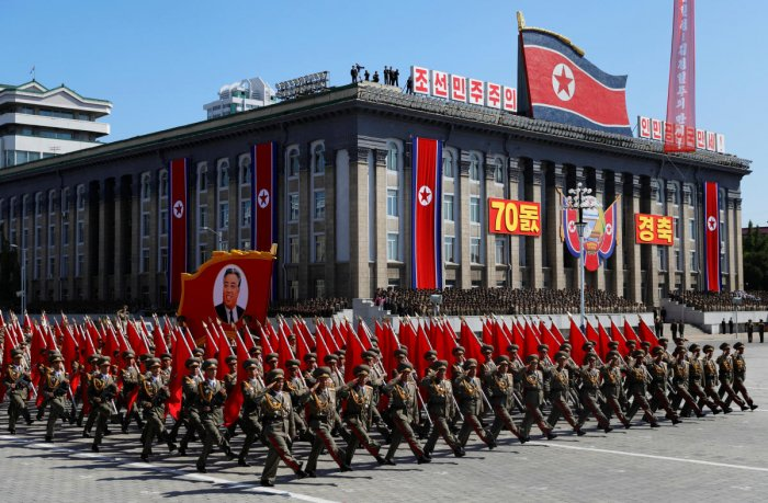 Soldiers march with the portrait of North Korean founder Kim Il Sung during a military parade marking the 70th anniversary of country's foundation in Pyongyang, North Korea, September 9, 2018. REUTERS/Danish Siddiqui