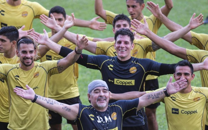Argentine legend Diego Maradona (foreground) gestures with the players during his first training session as coach of Mexican football club Dorados on Monday. AFP