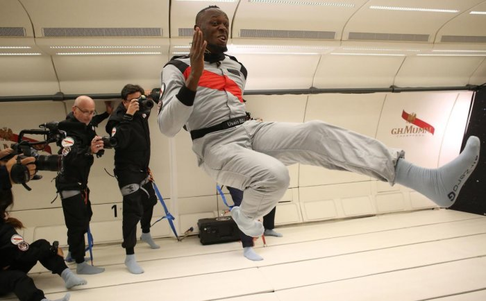 This photo released by Mumm/Novespace shows Usain Bolt (centre) in zero-gravity conditions in an aircraft on Wednesday above Reims. AFP