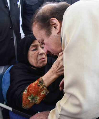 Pakistan's former prime minister Nawaz Sharif takes blessings from his mother before leaving for Aidiala Jail in Rawalpindi on September 17, 2018. PTI