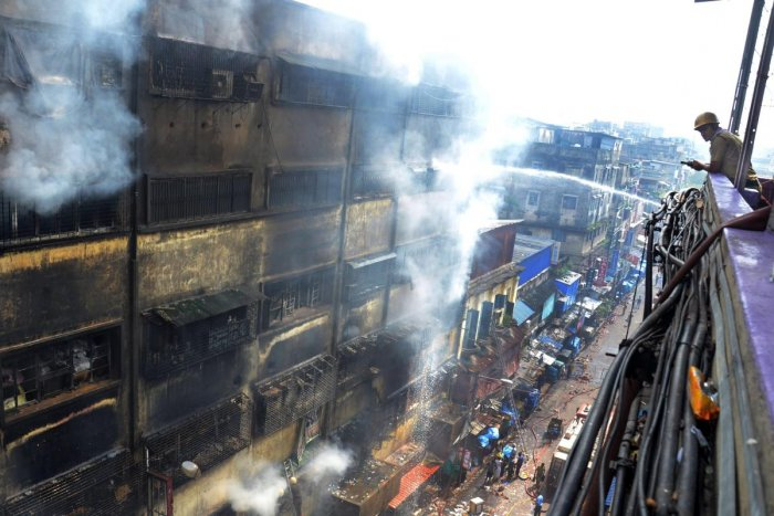 The fire gutted at least 1,000 business establishments inside the G+5 building, causing huge losses to traders ahead of Durga Puja. (PTI Photo)