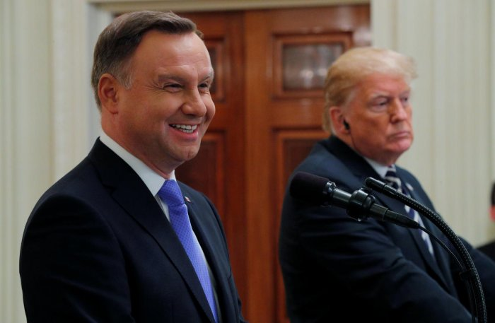 Poland's President Andrzej Duda smiles as he answers a question during a joint news conference with U.S. President Donald Trump in the East Room of the White House in Washington, U.S., September 18, 2018. REUTERS/Brian Snyder