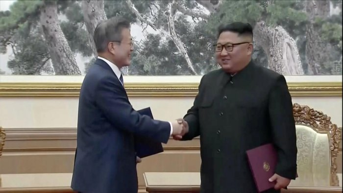 South Korean President Moon Jae-in and North Korean leader Kim Jong Un shake hands after signing documents during the inter-Korean summit at the Paekhwawon State Guesthouse in Pyongyang, North Korea in this still frame taken from video September 19, 2018.