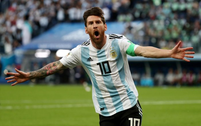 Argentina's Lionel Messi celebrates scoring their first goal. (REUTERS Photo)
