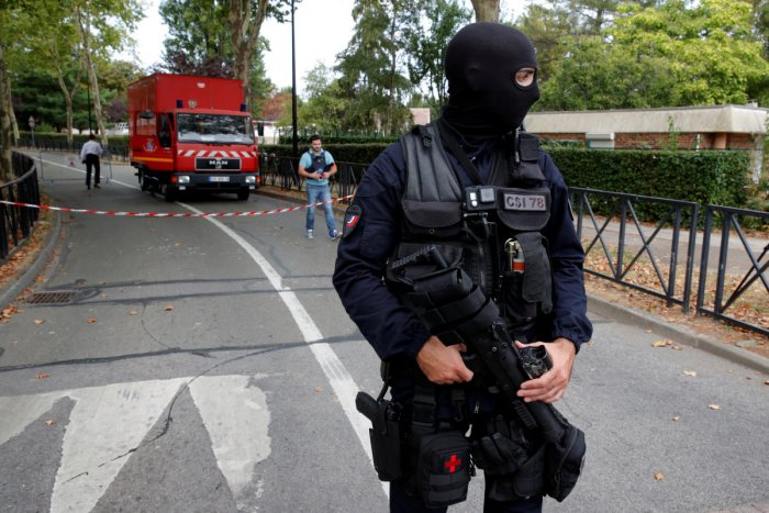 French police secure a street after a man killed two persons and injured an other in a knife attack in Trappes, near Paris, according to French authorities, France. Reuters photo