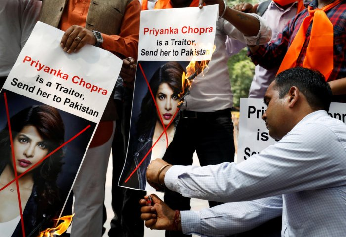 Supporters of Hindu Sena, a right wing group, burn posters of actor Priyanka Chopra during a protest, in New Delhi on Saturday. REUTERS