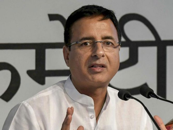 """Attacking the BJP for accusing Congress president Rahul Gandhi's as being the """"invisible hand"""" behind the petitions seeking the probe, party spokesperson Randeep Singh Surjewala termed the allegations as a """"malicious attempt"""" which showed the ruling party's """"jitteriness"""". (PTI file photo)"""