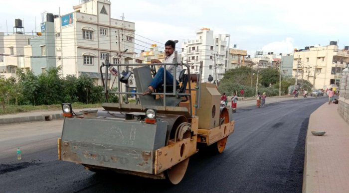 BBMP workers patching up potholes after the high court order.
