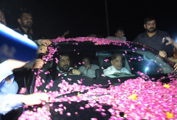 Former Pakistani mrime minister Nawaz Sharif (centre-back) sits in a vehicle alongside his younger brother Shahbaz Sharif (right) following his release from Adiala prison in Rawalpindi on September 19, 2018. AFP