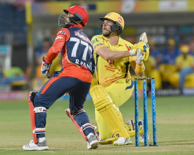 BIG HIT: Shane Watson hammers one for a six en route his 78 against Delhi Daredevils on Monday. AFP