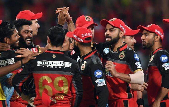 RAZOR SHARP: RCB's players celebrate the run out of Mumbai Indians' J P Duminy in the IPL match in Bengaluru on Tuesday. DH Photo/ Srikanta Sharma R