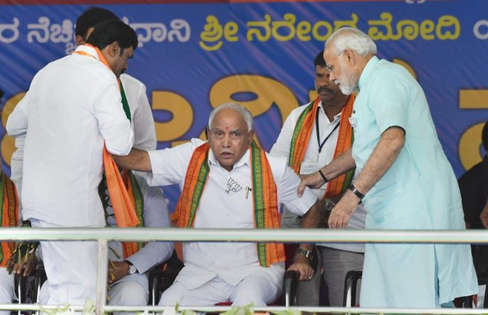 Chamarajanagar: Prime Minister Narendra Modi with BJP's chief ministerial candidate BS Yeddyurappa during Karnataka election campaign rally at Chamarajanagar on Tuesday. PTI Photo(PTI5_1_2018_000099B)