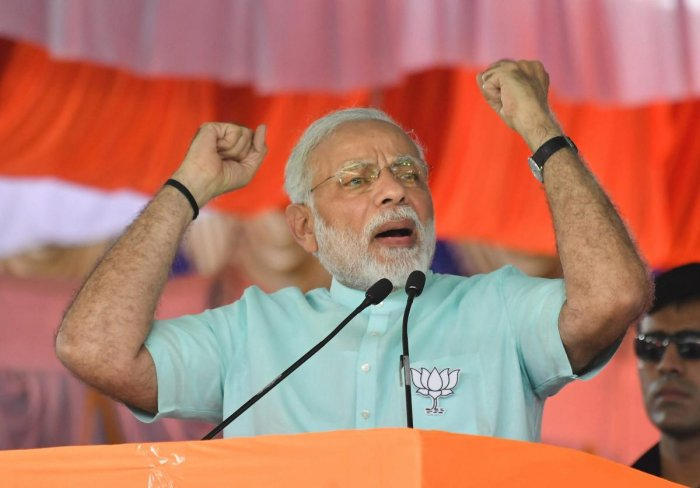 Prime Minister Narendra Modi speaks during Karnataka election campaign rally at Chamarajanagar on Tuesday. PTI Photo