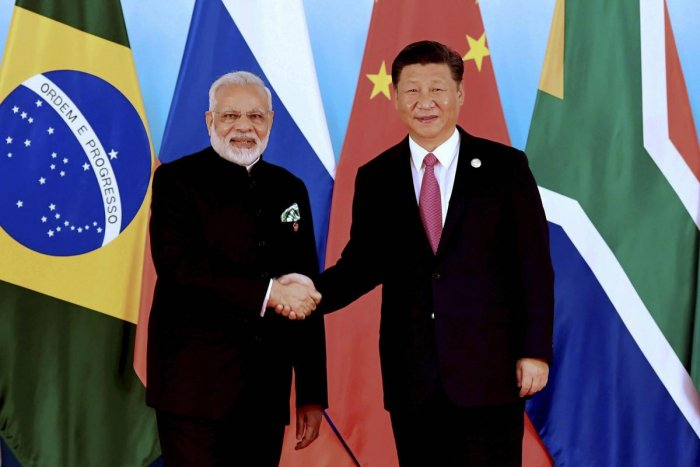 Chinese President Xi Jinping, right, shakes hands with Indian Prime Minister Narendra Modi at the BRICS Summit in Xiamen. AP/PTI file photo