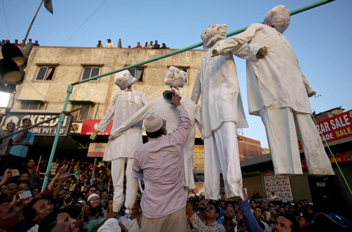 A man beats an effigy of one of the rapists at a protest against the rape of an eight-year-old girl, in Kathua, near Jammu, a teenager in Unnao, Uttar Pradesh state, and an eleven-year-old girl in Surat, in Ahmedabad. Reuters.