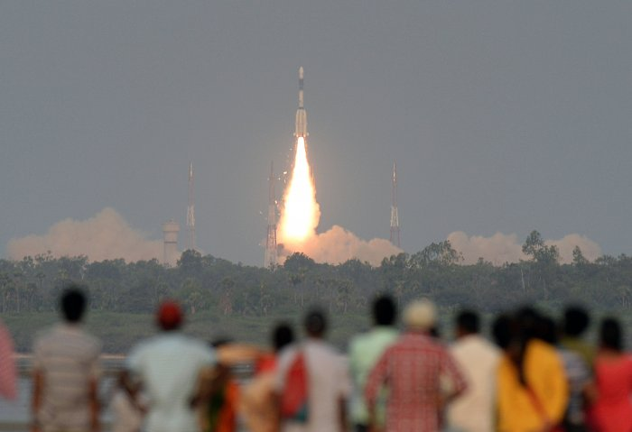 People watch as a GSAT-6A satellite takes off on the Geosynchronous Satellite Launch Vehicle from Sriharikota. (AFP file pic)