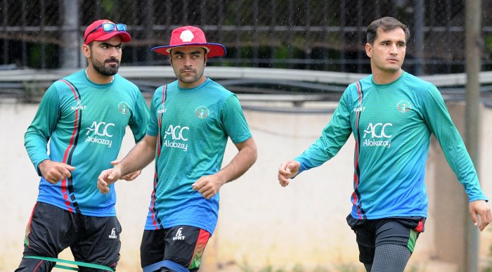Afghanistan players warm-up before a practice session on the eve of the Test match against India in Bengaluru on Wednesday. DH Photo/ Srikanta Sharma R