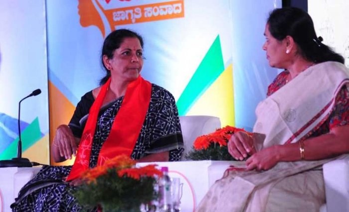"Defence Minister Nirmala Sitharaman addressing a gathering as part of BJP""s women outreach interactive programme called 'Karunada Mahila Jagruthi'in Bengaluru. Photo via Twitter."