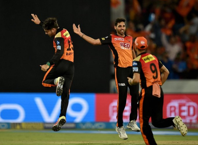 Sunrisers Hyderabad's Rashid Khan (left) and Bhuvneshwar Kumar (centre) have been the pick of their bowlers. PTI