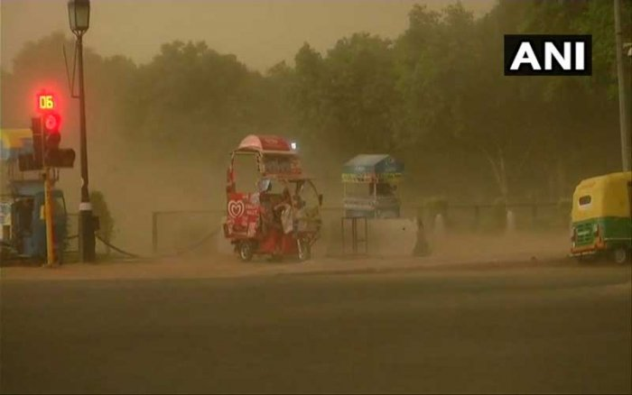 In a sudden change of weather, the sky turned cloudy around 4:30 pm and gusty winds swept the city. Image: ANI Twitter