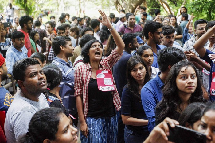 Jawaharlal Nehru University students wait to place their votes during the students' union polls, in New Delhi, Friday. PTI