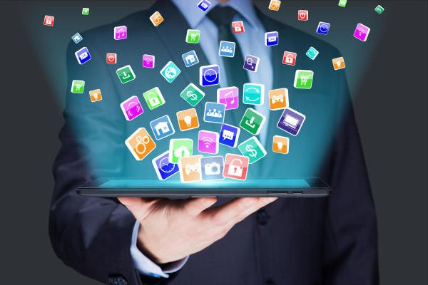 Businessman holding a tablet pc with mobile applications icons on virtual screen . Internet and business