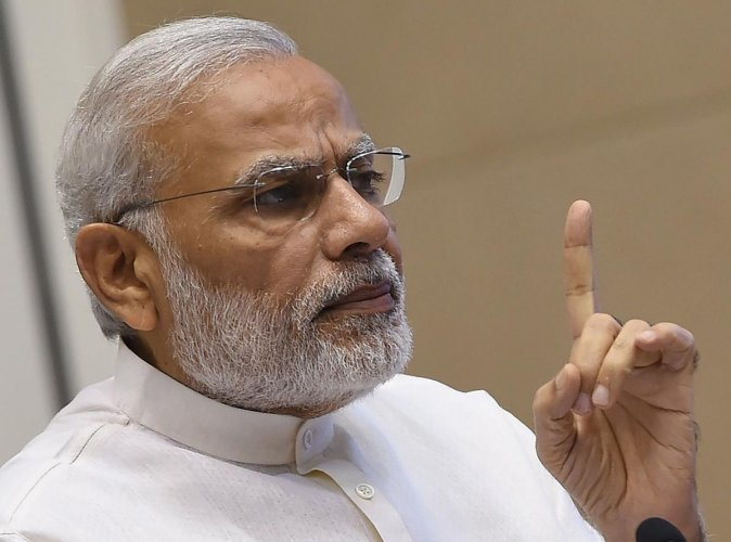 This file photo taken on September 30, 2016 shows India Prime Minister Narendra Modi gesturing while delivering a speech during the inauguration of the Indian Sanitation Conference in New Delhi.