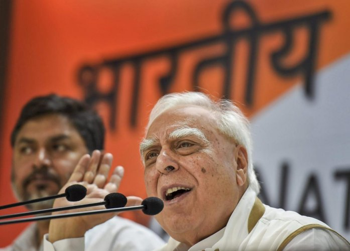 "Senior Congress leader Kapil Sibal said on Friday, ""I don't think you should credit Modi when he wins state elections because he is popular. It is because the Opposition is not united."" PTI file photo"