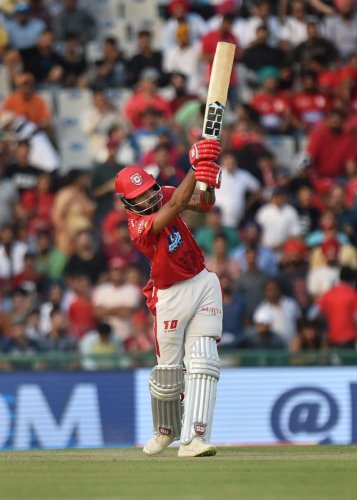 Kings XI Punjab's K L Rahul feels his opening partner Chris Gayle has taken some pressure off him. PTI