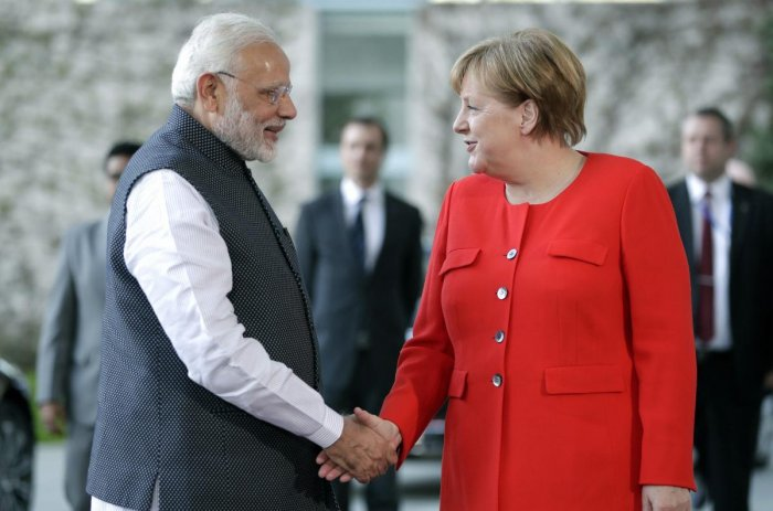 German Chancellor Angela Merkel, right, welcomes the India's Prime Minister Narendra Modi, left, for a meeting at the chancellery in Berlin, Germany, Friday, April 20, 2018. AP/ PTI