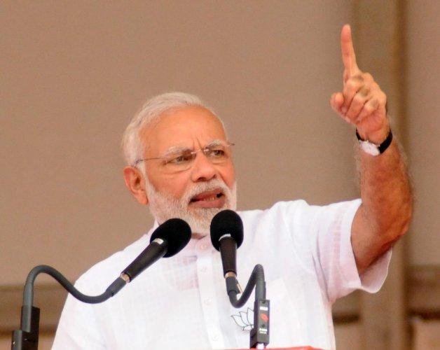 Modi was addressing the poll campaign rally for BJP candidates of Tumakuru district at Mahatma Gandhi Stadium in Tumakuru on Saturday. DH File Photo