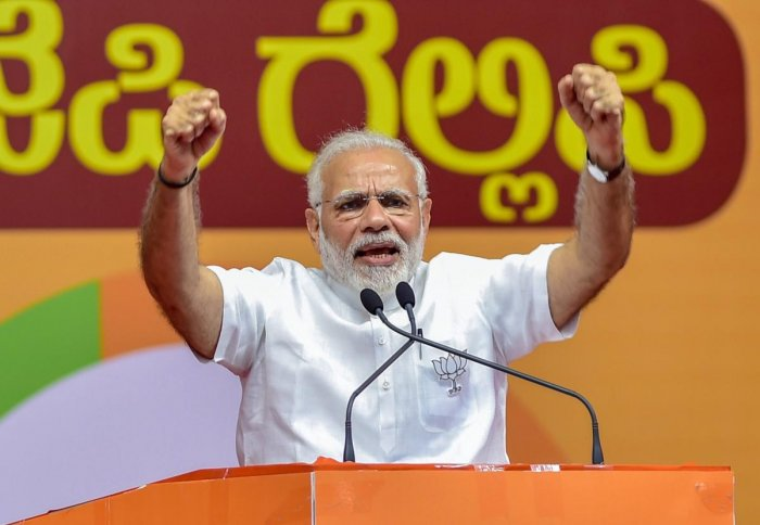 Prime Minister Narendra Modi addresses a public rally for the Karnataka assembly elections, in Bengaluru on Thursday. PTI Photo