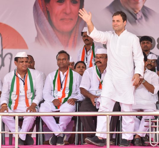 AICC President Rahul Gandhi waves to the crowd during public meeting for assembly elections at Kalagi in Kalaburagi District on Friday. Seen - Ajay Singh of Jewargi, PRiyank Kharge of Chittapur, Umesh Jadhav of Chincholli. DH Photo / Prashanth HG