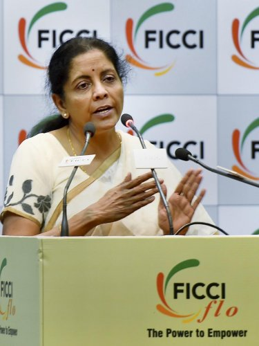 """Union Defence Minister Nirmala Sitharaman addresses a FLO interactive sesion on """"Stories That Matter - Journey of India's First Full-Time Defence Minister"""" in New Delhi on Monday. PTI"""