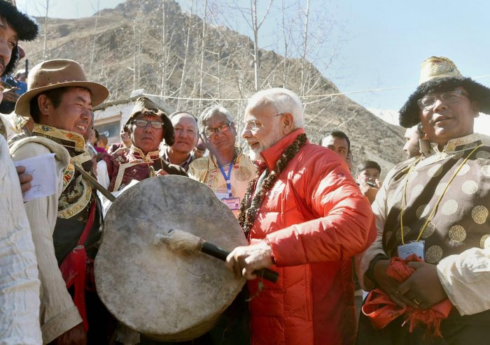 Prime Minister Narendra Modi beats a drum at Muktinath Temple in Muktinath on Saturday. (PTI Photo/PIB)