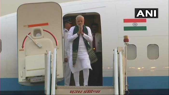 Prime Minister Narendra Modi coming out of the aeroplane after his Nepal visit. (ANI)