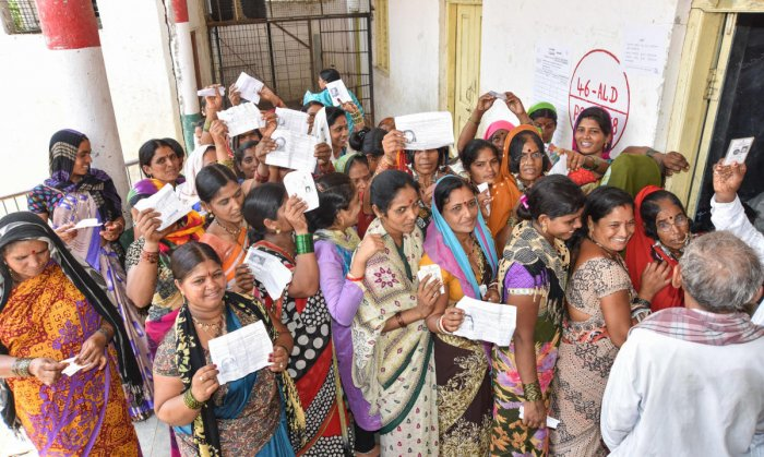 Women stand in Queue to exercise their franchise for Assembly Election at Korahalli village in Aland taluk in Kalaburagi District on Saturday. - Photo/ Prashanth HG