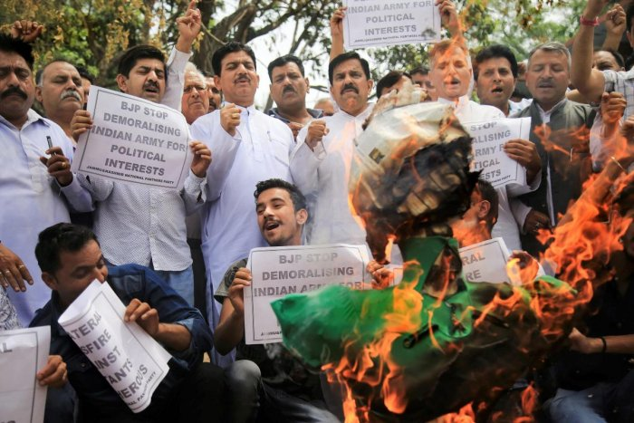 Jammu and Kashmir Nation Panthers Party (JKNPP) activists burn the effigy of Chief Minister Mehbooba Mufti over her appeal for 'unilateral ceasefire', in Jammu on Thursday. PTI Photo