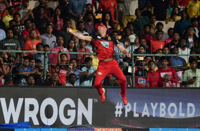AB De Villiers takes a catch to dismiss Alex Hales in Bengaluru on Thursday. PTI