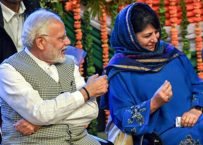 Prime Minister Narendra Modi with Jammu & Kashmir Chief Minister Mehbooba Mufti after inaugurating Kishanganga Power Station (330 MW) Bandipora, during a function at SKICC in Srinagar, on Saturday. PTI