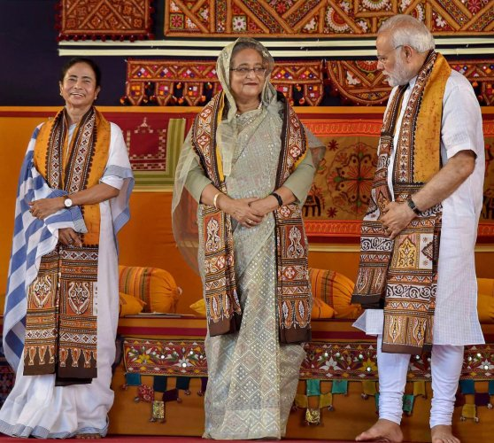 Prime Minister Narendra Modi speaks with his Bangladeshi counterpart Sheikh Hasina as West Bengal Chief Minister Mamata Banerjee looks on, during the annual convocation of Visva Bharati University, in Birbhum, on Friday. PTI Photo