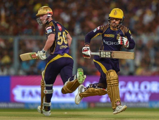 Kolkata Knight Riders (KKR) batsmen Chris Lynn and Nitish Rana cross each other to complete a run during the Indian Premier League (IPL) 2nd qualifier cricket match against Sunrisers Hyderabad (SRH), at Eden Garden, in Kolkata, on Friday.