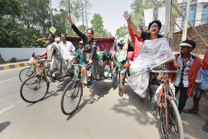 Congress women riding rickshaw during a protest against the rising fuel prices, essential commodities and the 4th anniversary of the Narendra Modi-led BJP government, in Patna on Saturday. ( PTI Photo)