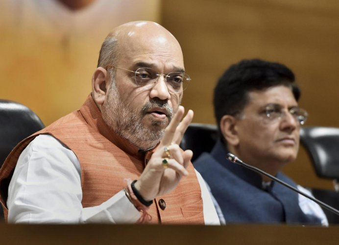BJP National President Amit Shah addresses a press conference at BJP headquarters, in New Delhi, on Saturday.Union Minister Piyush Goyal also seen in the pix. (PTI Photo)