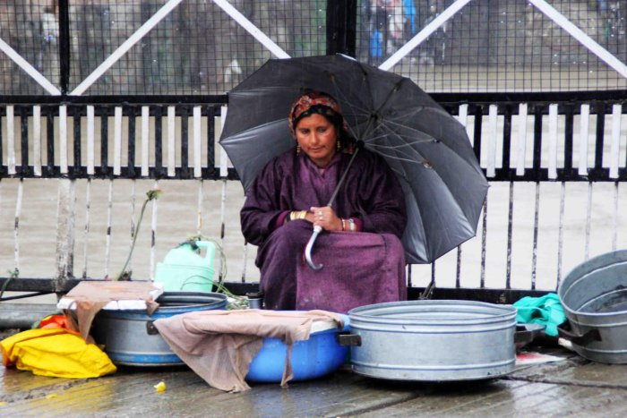 A fisherwoman sells fish in Srinagar. Umer Asif